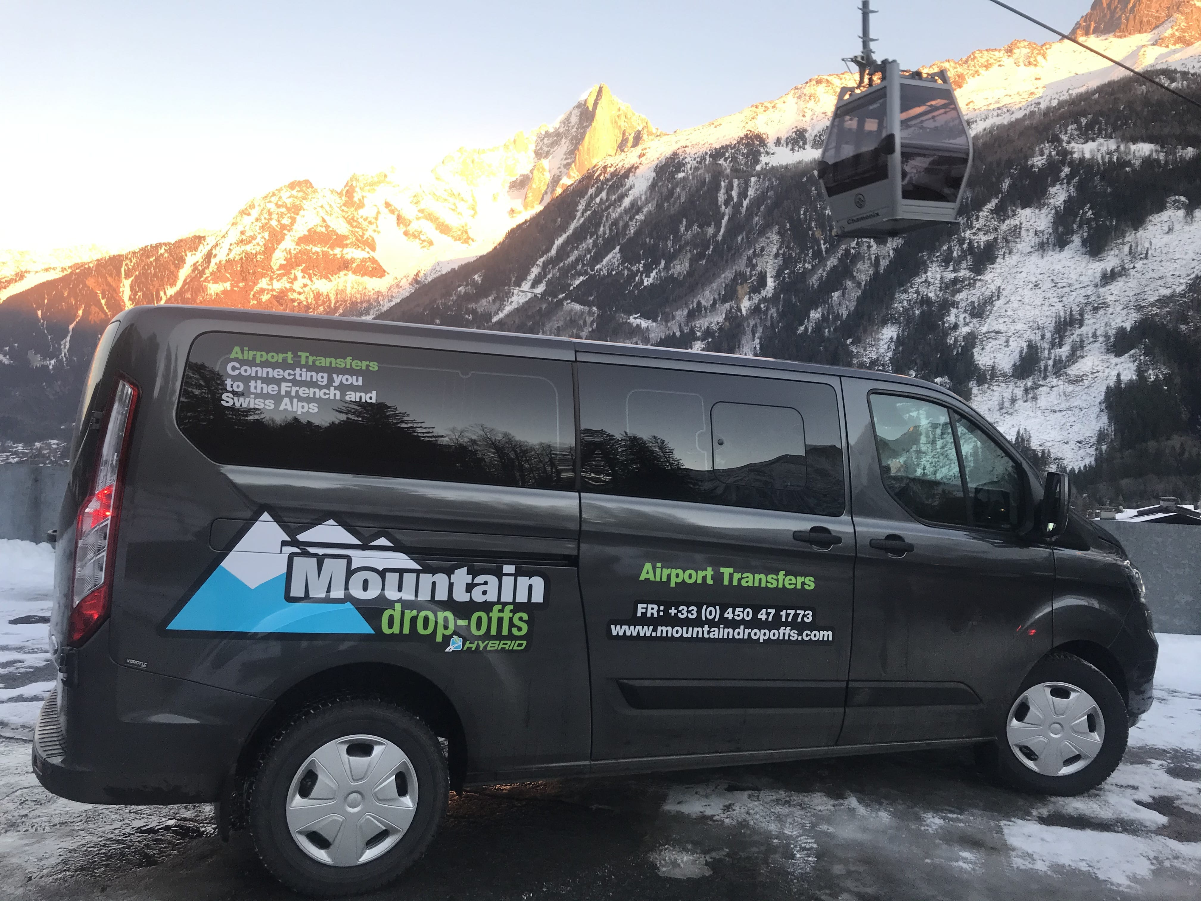 Chamonix transfer hybrid transfer vehicle in front of mountains